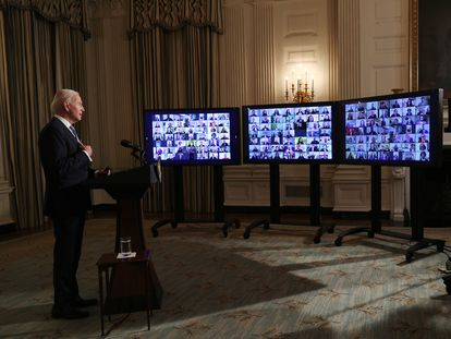 US President Joe Biden swears in appointees in a virtual ceremony at the White House after his inauguration.