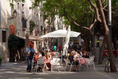 Street cafés on the pedestrianized Carrer Allada Vermell.