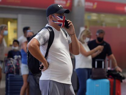 A traveler in Tenerife airport on July 26.