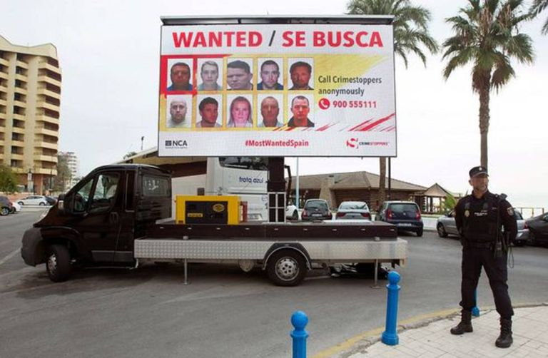 A billboard showing those wanted for arrest in Costa del Sol.