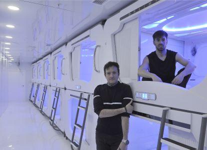 Iñaki Zabala (l) and Iker Caballero in the pod hostel Optimi Rooms in Bilbao.