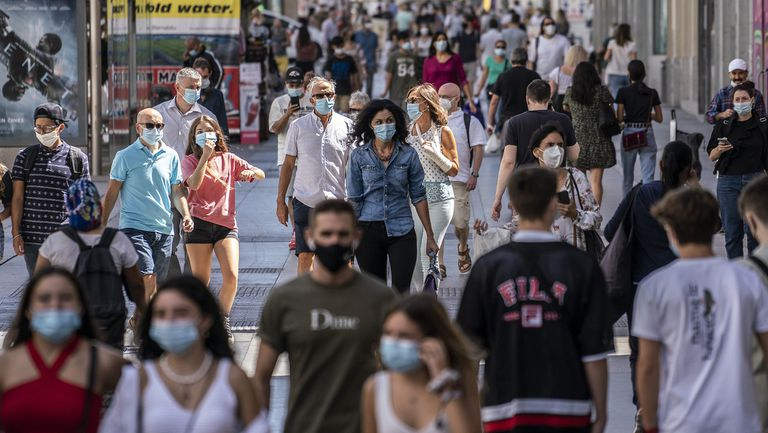Pedestrians walk down Madrid's Gran Vía avenue in September.