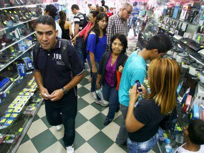 Venezuelans take to the stores on Wednesday.