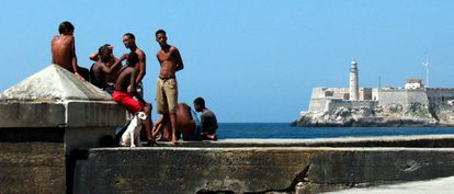 A group of young people at the Malecón in Havana, Cuba.