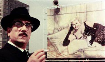 A scene from Federico Fellini's 1962 film 'Bocaccio 70.' Actress Anita Ekberg holds a glass of milk.