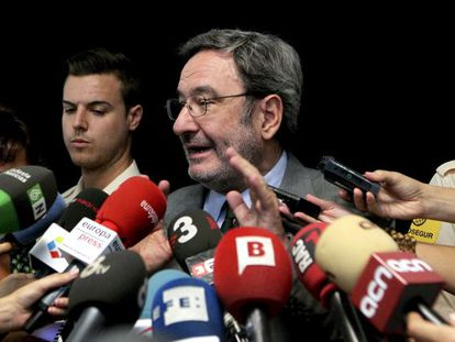 Former Caixa Catalunya chairman Narcis Serra attends to the press after a court appearance on criminal mismanagement case.