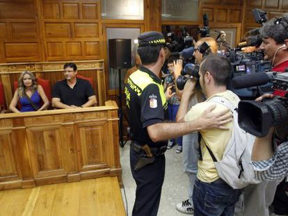 Television cameramen jostle for their angle at the council meeting in which Olvido Hormigos announced she would not be resigning