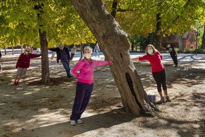 Masked Madrileños take excercise in the Spanish capital's Retiro Park.