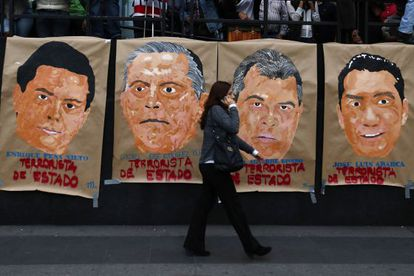 Posters demanding justice in the case of the 43 missing Mexican students.