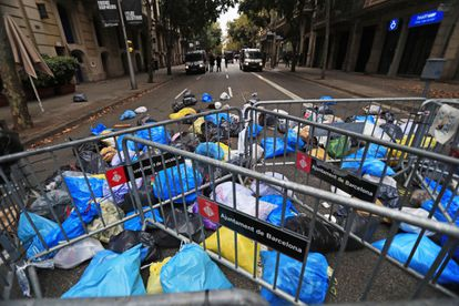 Protesters throw bags of trash in front of the security cordon outside the central government's delegate building in Barcelona on Sunday.
