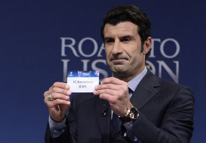 Former Barcelona and Real Madrid midfielder Luis Figo plucks the Catalan club out of the tombola at the Uefa draw ceremony on Monday.