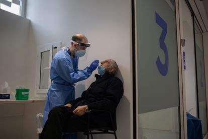 A man receives a PCR coronavirus test at Barcelona's Vall de Hebrón hospital.