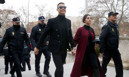 Ronaldo and his partner, Georgina Rodríguez, arrive at the Madrid court on Tuesday morning.