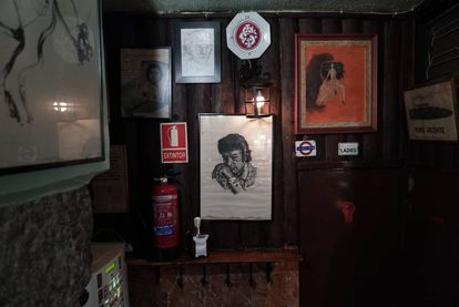 The east wall of the bar, which features a portrait of Enrique Morente, one of the flamenco greats.