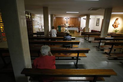 Worshipers pray at a chapel in Madrid.