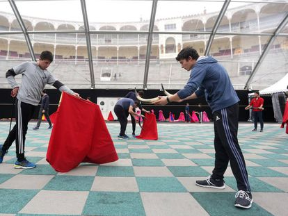 Students at practice at the bullfighting academy.