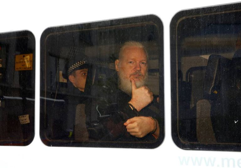 Julian Assange inside a police van after his arrest on April 11.