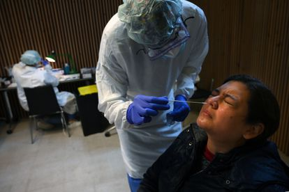 A healthcare worker conducts an antigen test during a mass coronavirus screening at Santa Creu i Sant Pau Hospital in Barcelona.