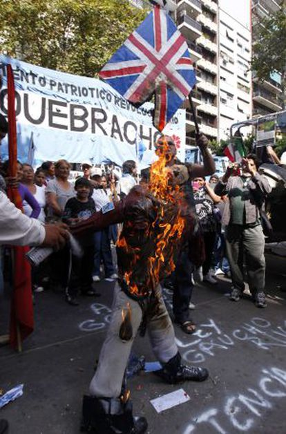 Protestors burn an effigy of Prince William outside the British Embassy.