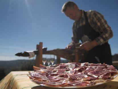 Eduardo Donato serves some of his prized ham.