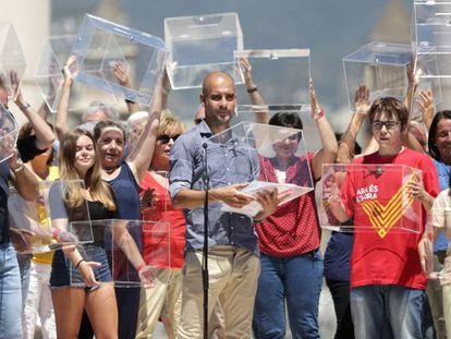 Manchester coach Pep Guardiola reading the manifesto in Barcelona.