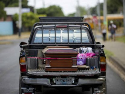 The body of Vilma Trujillo is driven home for burial.