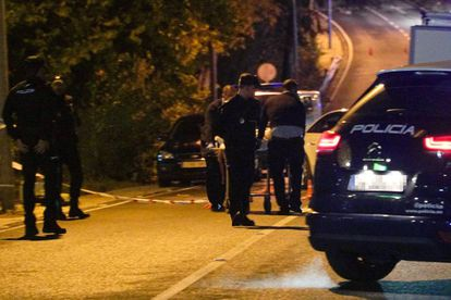 Police taking away the body of a man shot in Cabopino (Marbella).