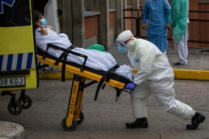 A patient is moved into an ambulance at the Severo Ochoa hospital in Leganes.