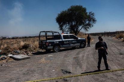 Guadalajara's metropolitan police cordon off the area where a body was found on February 17.
