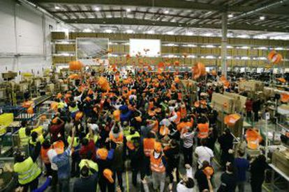 Photo handed out by Amazon of employees in Madrid celebrating announcement of the company's expansion.