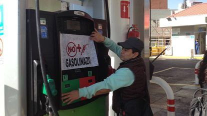 A man in Mexico City protests against a recent hike in gas prices.