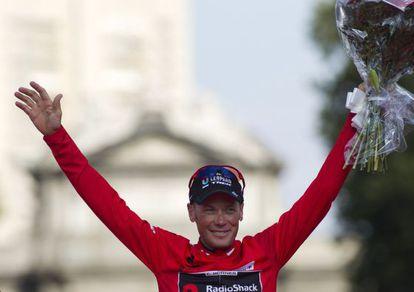 "RadioShack's US rider Chris Horner celebrates on the podium after winning the ""Vuelta"" Tour of Spain in Madrid on September 15."