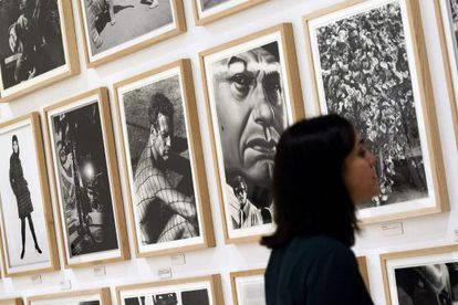 A visitor examines one of the 141 photos in the Dennis Hopper exhibition at the Picasso Museum, Málaga.