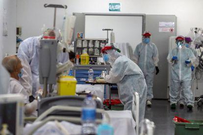 Health staff at work in Madrid's Puerta de Hierro hospital.