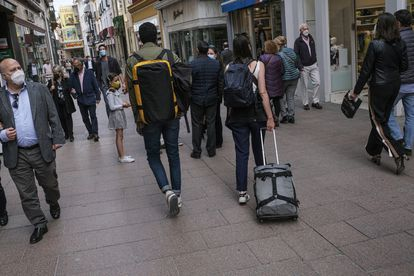 Tourists in downtown Seville.