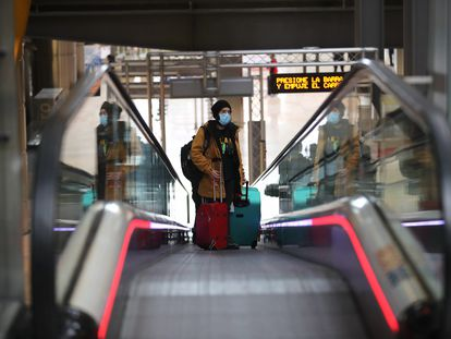 A passenger at Madrid's Barajas airport on Thursday.