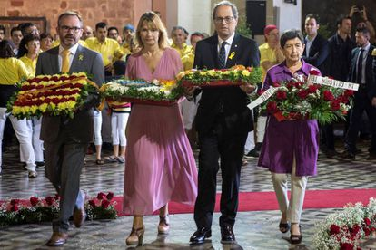 Catalan premier Quim Torra (second from right) and other officials laying out flowers to historical city leaders on Diada Day.