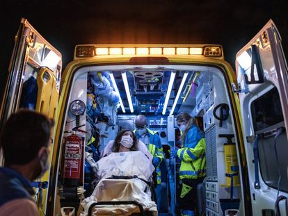 Health workers transport a patient in Madrid.