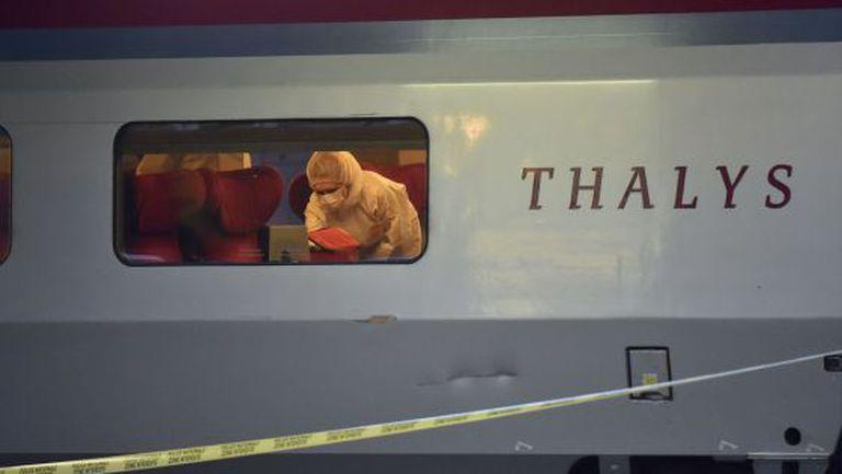 Police inspect the train carriage in which the attack took place.