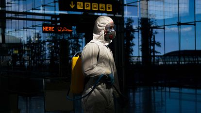 A member of the Military Emergencies Unit carries out a general disinfection at Malaga airport on March 16.