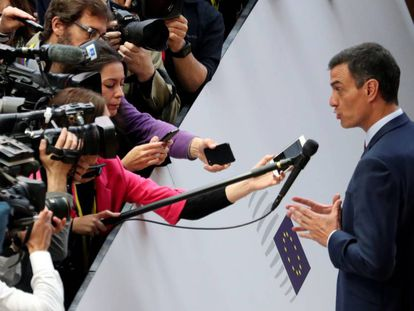 Pedro Sánchez talks to the media as he arrives at a European Union leaders summit.