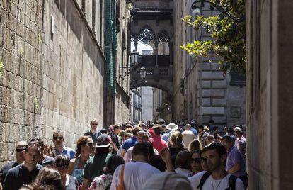 Tourists filling up Barcelona's Gothic neighborhood.