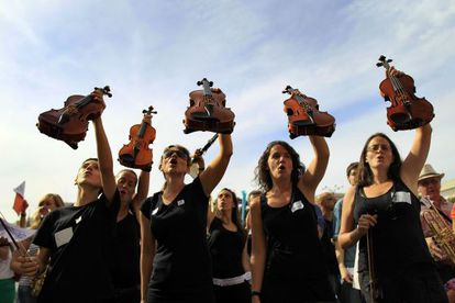 Students and teachers stage a protest against spending cuts for municipal music schools in Madrid.