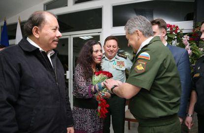 President Daniel Ortega, left, and his wife Rosario Murillo greet Russian Defense Minister Sergei Shoigu.