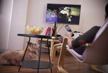 A woman watches the trailer for the new 'Star Wars' movie on her TV.
