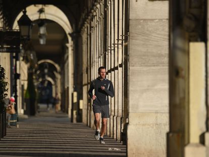 A man jogs in Paris, France, where members of the public can go out onto the street for an hour of physical activity a day under lockdown rules.