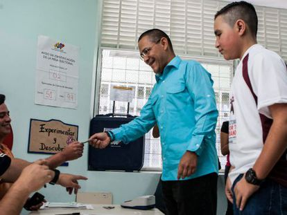 Ernesto Villegas, the ruling PSUV party's candidate in Caracas, casts his vote on Sunday.