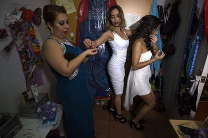 Aleja's mother and sister helping her get ready.
