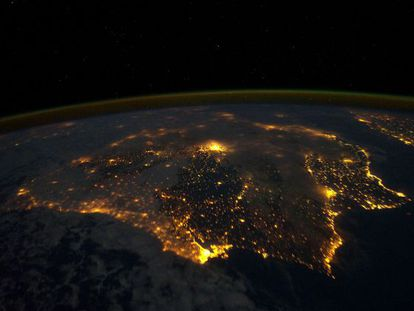 An image taken by the international space station of Spain at night. Madrid is seen in the middle glowing furiously.