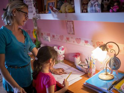 Five-year-old Almudena does her homework.